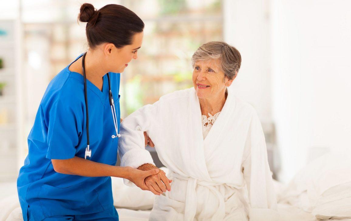 female-nurse-helping-an-elderly-woman-walk