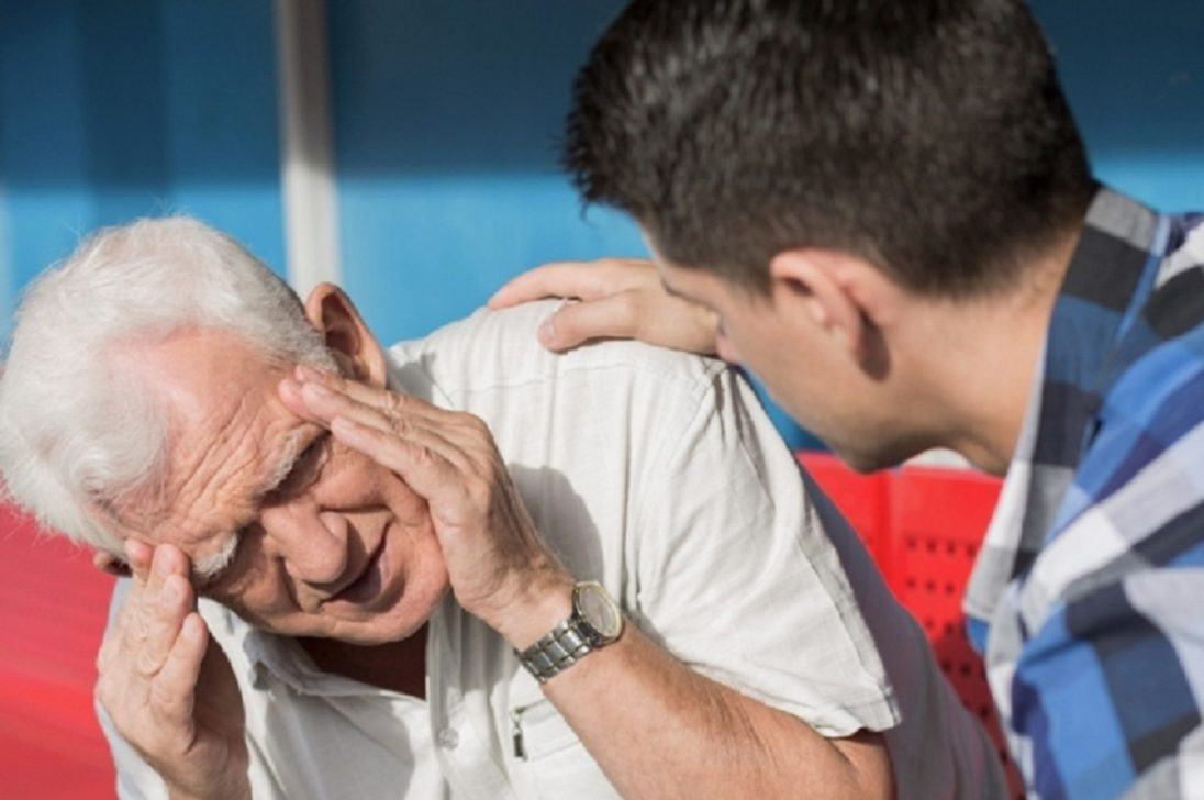 Senior man suffering from dizziness