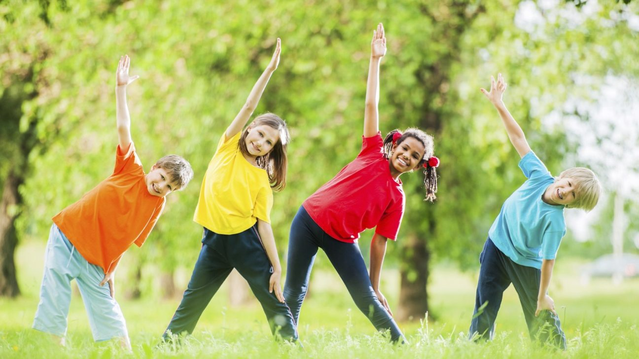 Cheerful kids doing stretching exercises.