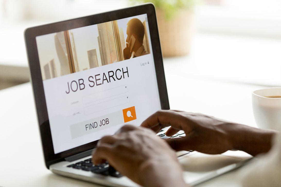 African-american man browsing work online using job search computer app